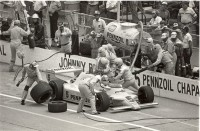 Johnny Rutherford visits the pits in the 1982 Indianapolis 500