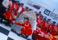 Jimmy Vasser counts his money after winning the 1996 US 500